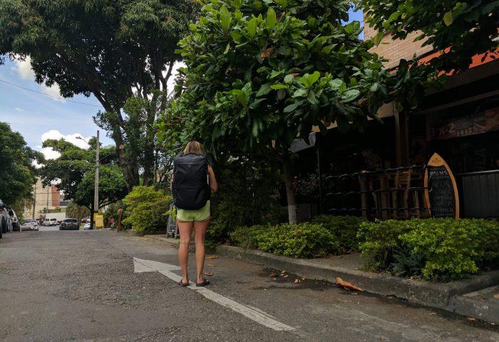 Woman wearing a Tortuga Backpack